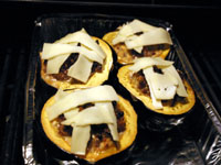 melted cheese on stuffed squash