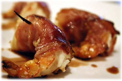 shrimp wrapped in bacon drizzled with balsamic