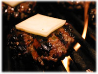 bbq beef cheese burger on the grill