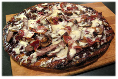 bbq cheesesteak pizza on the grill