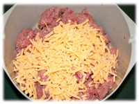 shredded cheese in burger mixture