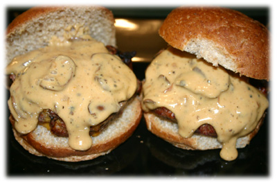 cheeseburgers smothered in cheese sauce