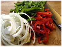 sliced peppers onions