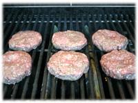 grilling a gourmet hamburger