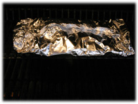 potatoes on the grill in foil packs