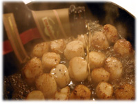 pouring Drambuie on scallops