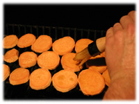 sweet potato discs on grill