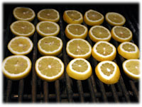 sliced lemons on the grill