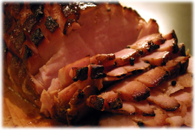carving a smoked ham