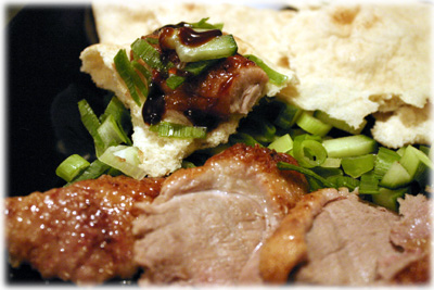 sliced peking duck with chinese pancakes