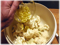 garlic and oil on cauliflower pieces