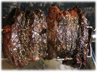 sirloin roast cooked on bbq rotisserie