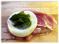 provolone and basil on prosciutto