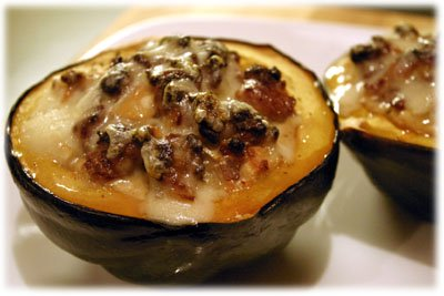 Amazing sausage and apple stuffed acorn squash recipe from tasteofBBQ.com
