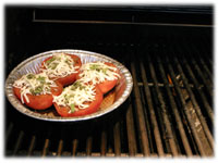 cooking baked tomatoes on the BBQ