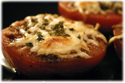 Amazing cheesy baked tomatoes topped with fresh basil and oregano from tasteofBBQ.com