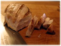 slicing a grilled chicken breast