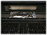 foil wrapped squash on upper grill rack