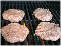 chicken burgers going on the grill