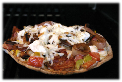 Pita Bread Pizzas on the grill by tasteofBBQ.com