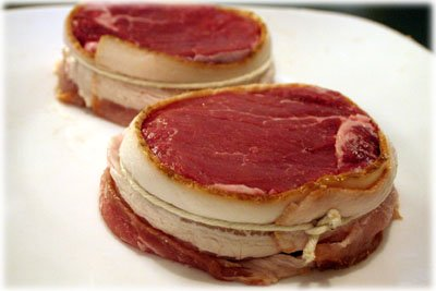 raw filet mignon steaks wrapped in bacon
