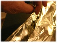 wrapping a baking potato in foil