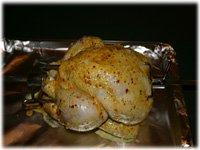 putting chicken on a rotisserie