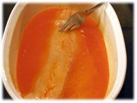dipping fish in franks red hot sauce