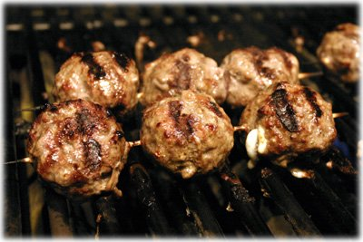 grilling meatballs on a skewer