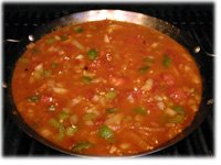 making paella on bbq grill