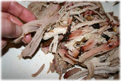 shredding pork for pulled pork sandwiches