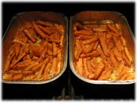 sweet potato fries in a pan on the grill