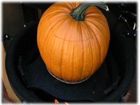 cooking stuffing in a pumpkin on bbq